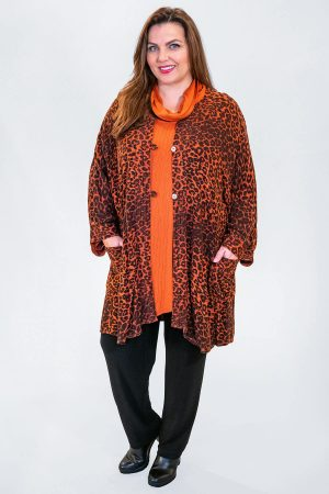 The model in this photo is wearing a head turning burnt orange leopard print jacket from Angel Circle teamed with an Angel Circle sousdi cowl tunic and Robell Elena skinny jeans in black