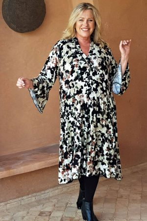 The model in this photo is wearing a Raella tiered dress from Kasbah Clothing