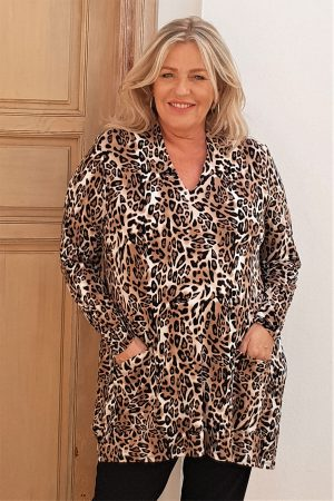 The model in this photo is wearing a soft v neck animal print jersey bubble cut tunic with pockets