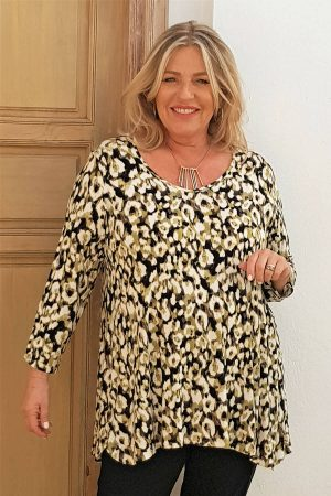 The model in this photo is wearing a gorgeous Kasbah Clothing Tyrrell top in green animal print