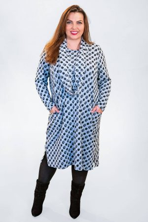 The model in this photo is wearing a super soft Mona Lisa dress with matching loop scarf available up to size 30 from Bakou