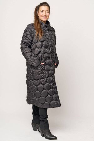 This model is wearing a lightweight Pont Neuf Cobina coat