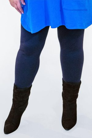 The model in this photo is wearing a pair of leggings by See You available up to size 30, in navy or black