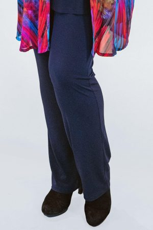 The model in this photo is wearing Yoek narrow silky jersey stretch trousers in navy